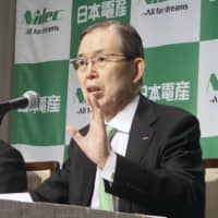 Nidec Corp.'s chairman Shigenobu Nagamori (right) speaks at a news conference in Tokyo on Tuesday. | KYODO