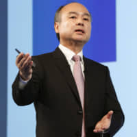 SoftBank Group Chairman Masayoshi Son explains his company's earnings for the April-December period at a news conference in Tokyo on Feb. 6. | KYODO