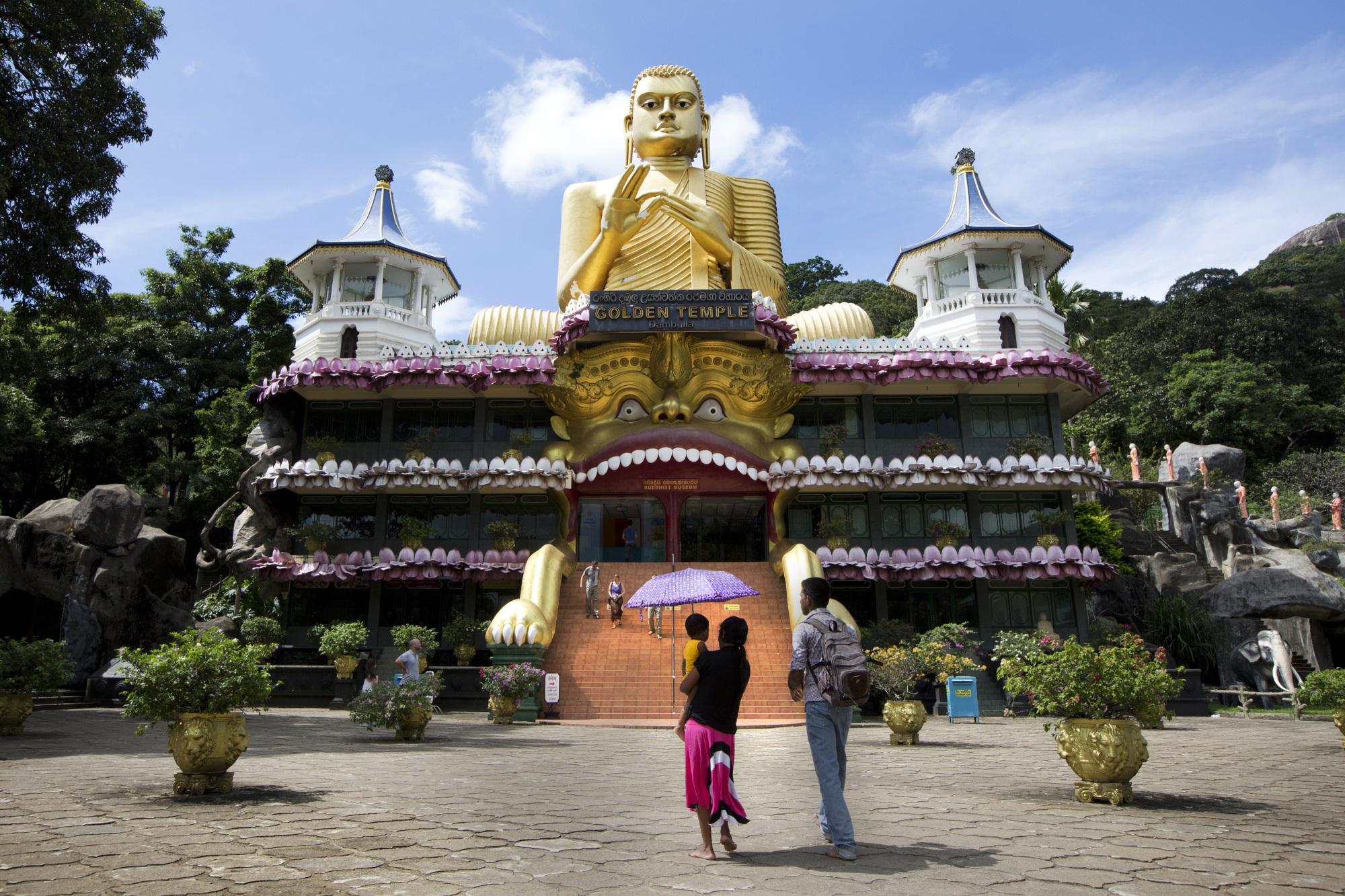 People visit the Golden Buddha statue at the Golden Temple of Dambulla in Central province, Sri Lanka, in January 2016. The suicide bombers who killed at least 290 people, including 32 foreign nationals, could bring the country's recent tourism boom to an end. | BLOOMBERG