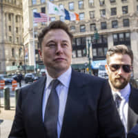 Elon Musk, chief executive officer of Tesla Inc., arrives at federal court in New York on April 4.   BLOOMBERG
