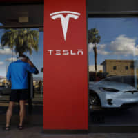Tesla Inc. CEO Elon Musk is locked in a Twitter spat with Panasonic Corp., the company that makes all of the lithium-ion battery cells that power Tesla's electric vehicles. | BLOOMBERG