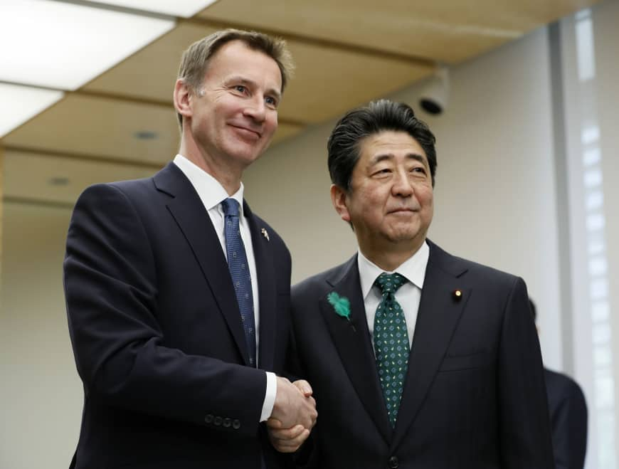 Jeremy Hunt, British Secretary of State for Foreign and Commonwealth Affairs, greets Prime Minister Shinzo Abe during a courtesy call at Abe's office in Tokyo on Monday.   AP