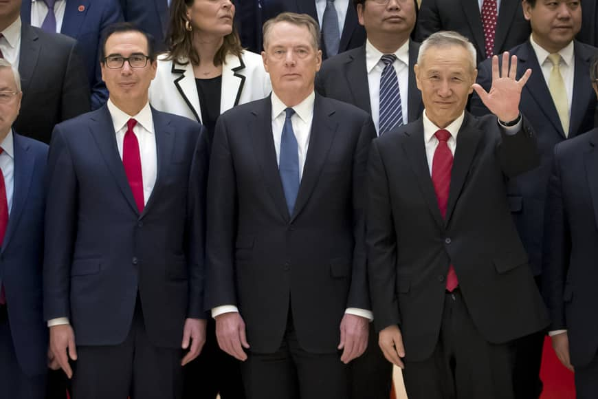Chinese Vice Premier Liu He gestures as he and U.S. Treasury Secretary Steven Mnuchin (left) and U.S. Trade Representative Robert Lighthizer pose for a group photo at the Diaoyutai State Guesthouse in Beijing April 11, noting trade talks with the U.S. are