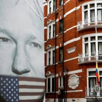 WikiLeaks founder Julian Assange arrested by British police at Ecuadorian Embassy