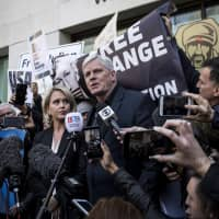 Kristinn Hrafnsson, editor in chief of WikiLeaks, speaks with members of the media with Jennifer Robinson, barrister (center left), outside the Westminster Magistrates' Court in London on Thursday. | BLOOMBERG