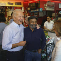 Democratic presidential candidate and former Vice President Joe Biden greets people at Gianni's Pizza in Wilmington, Delaware, on Thursday, hours after announcing his candidacy. | AP