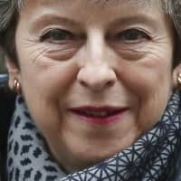 British Prime Minister Theresa May leaves No. 10 Downing St. to attend her weekly Prime Minster's Questions at the House of Commons on March 27. | AP