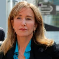 Actress Felicity Huffman arrives at Boston court to face college admissions bribe charges