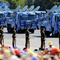 Anti-ship missiles roll into Beijing's Tiananmen Square in 2015 during a military parade marking the 70th anniversary of the end of World War II. | REUTERS