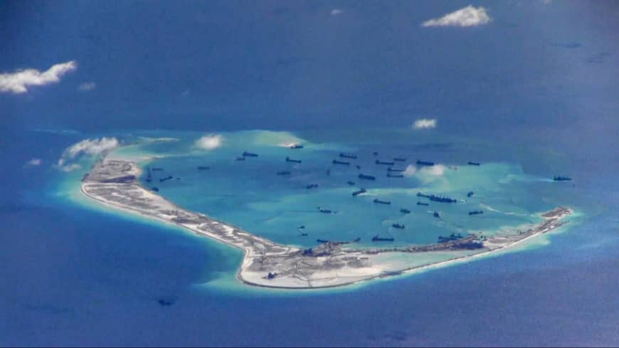 Chinese dredging vessels are purportedly seen in 2015 in the waters around Mischief Reef, in the disputed Spratly Islands in the South China Sea, in this still image from video taken by a U.S. P-8A Poseidon surveillance aircraft