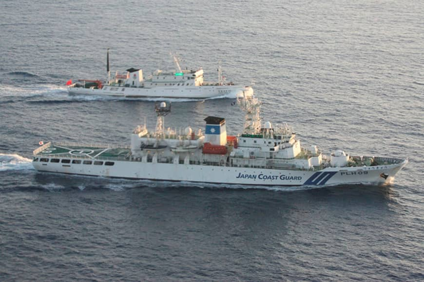 A Chinese patrol ship (top) sails side by side with a Japan Coast Guard patrol vessel in 2011 near disputed islands in the East China Sea, known as the Senkakus in Japan and Diaoyu in China.