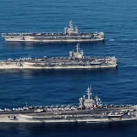 The aircraft carriers USS Ronald Reagan, USS Theodore Roosevelt and USS Nimitz conduct operations in international waters as part of a three-carrier strike force exercise in western Pacific in November 2017. | REUTERS