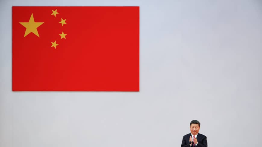 Chinese President Xi Jinping applauds during the swearing in ceremony of the new Hong Kong government on the 20th anniversary of the city