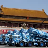 Chinese military vehicles carry DF-10 ship-launched cruise missiles as they travel in Beijing's Tiananmen Square during a military parade to commemorate the 70th anniversary of the end of World War II on Sept. 3, 2015. | REUTERS