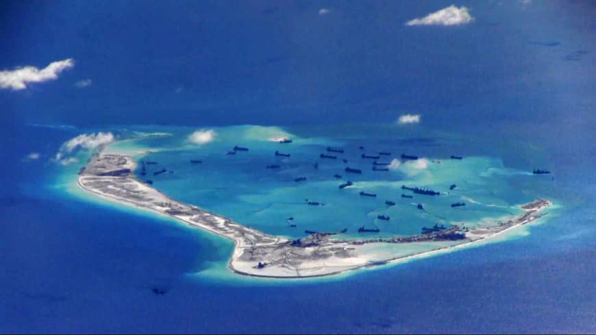 Chinese dredging vessels are seen in the waters around Mischief Reef in the disputed Spratly Islands of the South China Sea in this still image from video taken by a U.S. Navy P-8A Poseidon surveillance aircraft in May 2015.