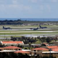 U.S. military planes are seen parked on the tarmac of Andersen Air Force base on the island of Guam, a U.S. Pacific territory, in August 2017. | REUTERS