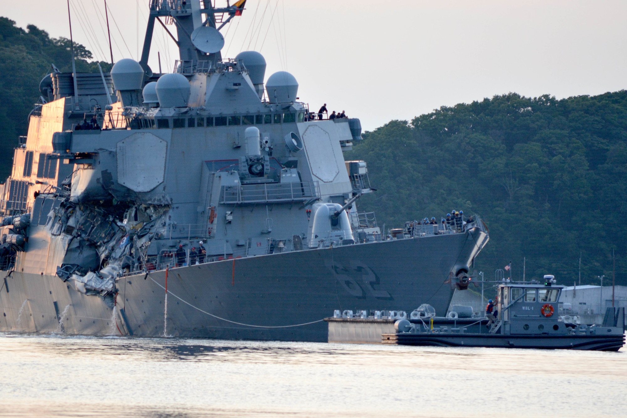 The USS Fitzgerald guided-missile destroyer returns to the U.S. Navy base in Yokosuka, Kanagawa Prefecture, on June 17, 2017, following a collision with a merchant vessel while operating southwest of Tokyo Bay. | NAVY MEDIA CONTENT SERVICES
