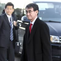 Foreign Minister Taro Kono arrives for the second day of a Group of Seven ministerial-level meeting in Dinard, France, on Saturday. | AP