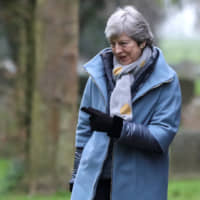 British Prime Minister Theresa May leaves a church near High Wycombe, England, on Sunday. | REUTERS