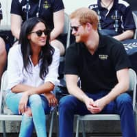 Britain's Prince Harry and his then-girlfriend, actress Meghan Markle, watch wheelchair tennis during the Invictus Games in Toronto in September 2017. | REUTERS