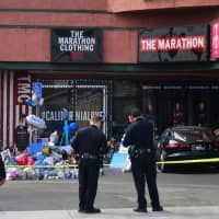 A makeshift memorial for Grammy-nominated rapper Nipsey Hussle sits in the parking lot in front of his Marathon Store in Los Angeles Tuesday. Hussle was shot dead in the lot Sunday, sparking an outpouring of grief from fellow celebrities as the city's mayor blamed 'senseless gun violence.' | AFP-JIJI