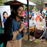 Shanti Ramchand gives a campaign speech in a shanty town near Jakarta on March 14. | REUTERS