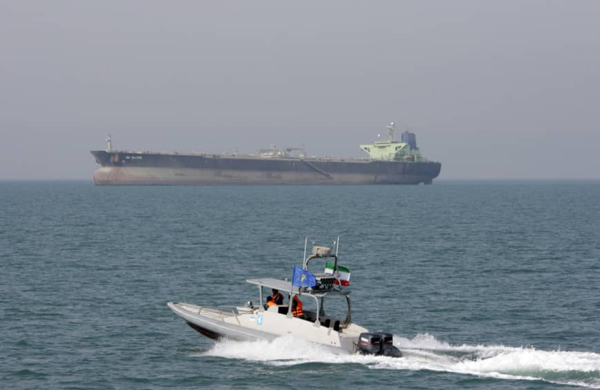 An Iranian Revolutionary Guard speedboat moves in the Persian Gulf near an oil tanker in 2012. On Monday, the Trump administration designated Iran's Revolutionary Guard a