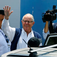 Former Peruvian President Pedro Pablo Kuczynski leaves the Institute of Legal Medicine and Forensic Sciences in Lima on Wednesday after a judge ordered his arrest. | REUTERS