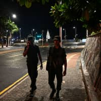 Sri Lankan soldiers patrol along a street during a curfew in Colombo Monday, a day after the series of bomb blasts targeting churches and luxury hotels in Sri Lanka. The death toll from the bomb blasts that ripped through churches and luxury hotels in Sri Lanka rose dramatically Monday to 290 — including dozens of foreigners — as police announced new arrests over the country's worst attacks for more than a decade. | AFP-JIJI