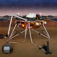 A life-size model of the spaceship InSight, NASA's first robotic lander dedicated to studying the deep interior of Mars, is shown at the Jet Propulsion Laboratory in Pasadena, California, in November. | REUTERS