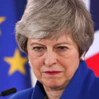 British Prime Minister Theresa May holds a news conference in Brussels on April 11 following an extraordinary European Union summit to discuss Brexit. | REUTERS