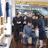 North Korean leader Kim Jong Un visits the Taesong Department Store in Pyongyang just before its opening in this photo released Monday. | REUTERS