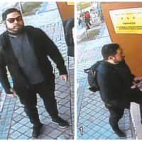 Photos taken from a surveillance video allegedly show former U.S. Marine Christopher Philip Ahn standing in front of and entering the North Korean Embassy in Madrid on Feb. 22. | REUTERS