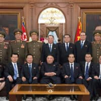 North Korean leader Kim Jong Un poses for a photo with newly elected members of the leadership bodies of the state in Pyongyang in this image released Saturday. | AFP-JIJI
