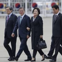 South Korean President Moon Jae-in and his wife, Kim Jung-sook, arrive to leave for the United States at Seoul Air Base in Seongnam, South Korea, on Wednesday. | AP