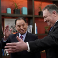 Kim Yong Chol, North Korea's lead negotiator in nuclear diplomacy with the United States, is escorted by U.S. Secretary of State Mike Pompeo during talks in Washington in January. | REUTERS