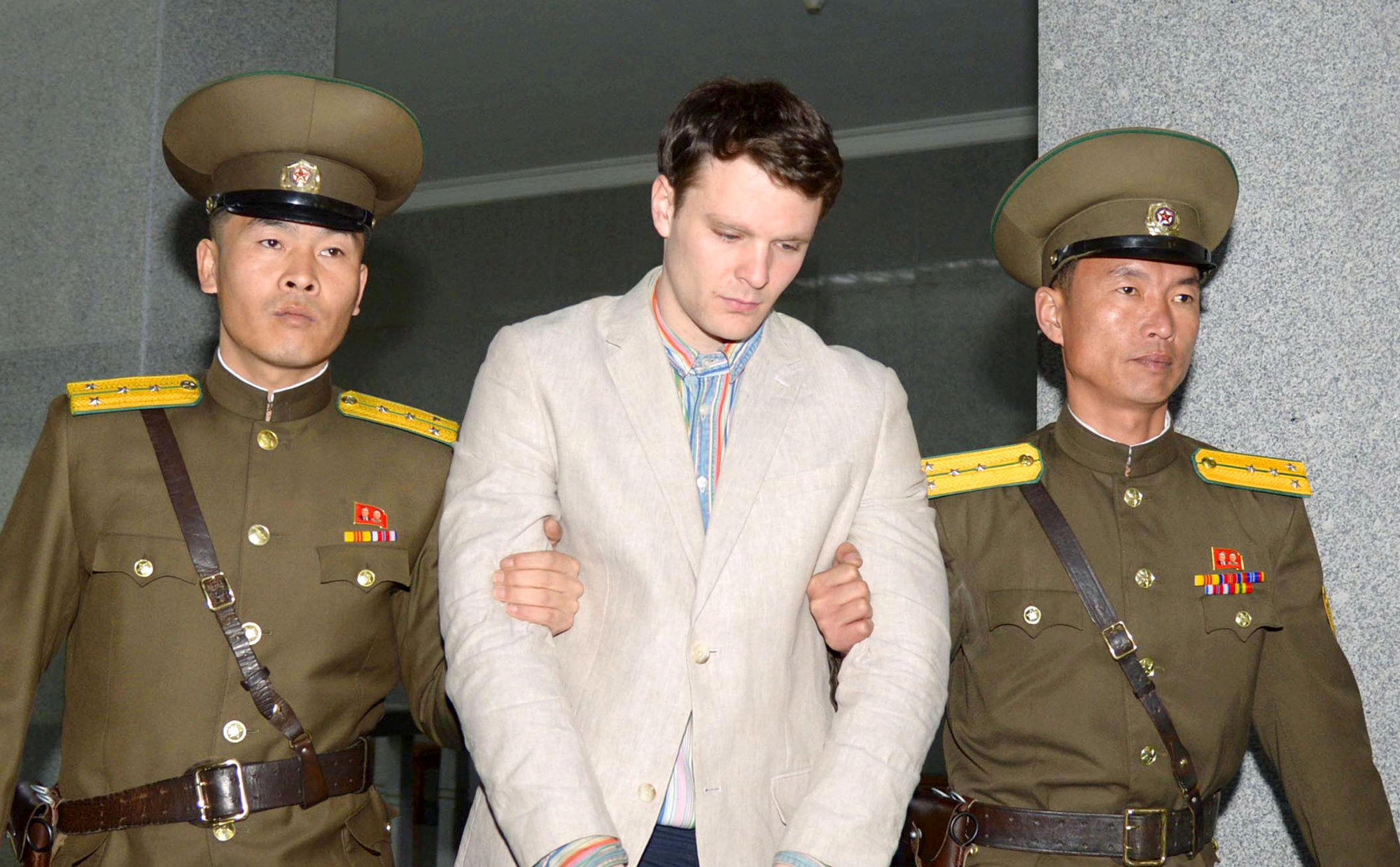 Otto Frederick Warmbier, a University of Virginia student who was detained in North Korea since early January, is taken to North Korea's top court in Pyongyang in this photo released by Kyodo on March 16, 2016. | KYODO / FILE PHOTO / VIA REUTERS