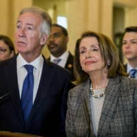 Nancy Pelosi, speaker of the United States of House of Representatives, faces the media with Richard Neal, chair to the House Ways and Means Committee, and members of an American delegation during a press conference in the Great Hall at Parliament Building in Belfast, Northern Ireland, Friday. | LIAM MCBURNEY / PA / VIA AP