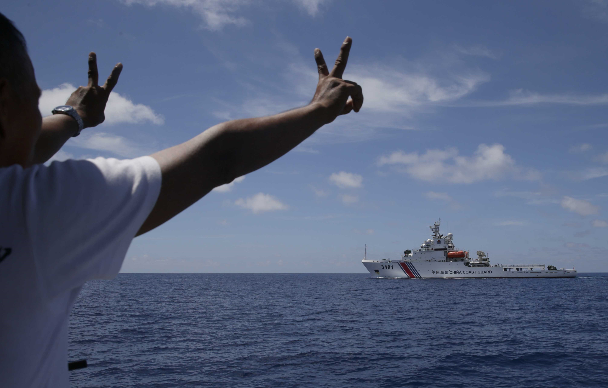 A China Coast Guard vessel attempts to block a Philippine government vessel in March 2014 as the latter tries to enter the China Second Thomas Disputed Shoals, locally known as Ayungin Shoal, for officials to address Philippine troops and deliver provisions. | AP