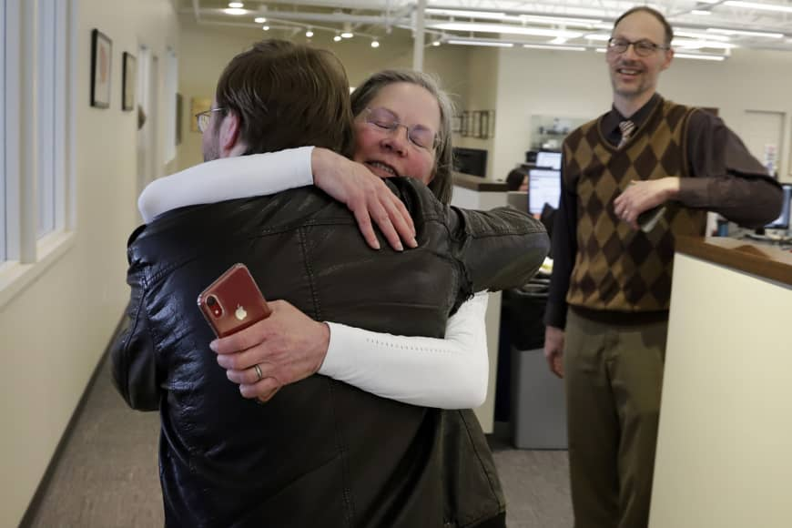 Pittsburgh Post Gazette City Editor Lillian Thomas hugs reporter Andrew Goldstein in the paper's downtown Pittsburgh newsroom after it was announced that the paper's staff coverage of the shooting at the Tree of Life Synagogue last October was awarded the Pulitzer Prize for Breaking News Reporting Monday. | AP