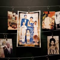 Pictures of Rwandan genocide victims are displayed at an exhibition at the Genocide Memorial in Gisozi in Kigali on Saturday. | REUTERS