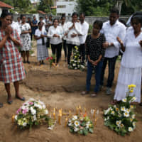 Foreigners swept up as Sri Lanka searches for clues to Easter Sunday bombings