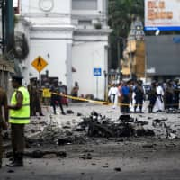 Sri Lanka imposes emergency and links international network to terror attacks that killed 290