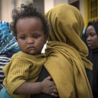 Sudanese refugees, who fled from the clashes between forces loyal to the internationally recognized Government of National Accord (GNA) and forces loyal to strongman Khalifa Haftar, rest at a school in Libya's capital Tripoli on Wednesday. | AFP-JIJI