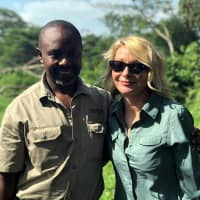 American tourist Kim Endicott and field guide Jean-Paul Mirenge pose Monday a day after they were rescued following their kidnapping by unknown gunmen in Uganda's Queen Elizabeth National Park. | WILD FRONTIERS / VIA AP