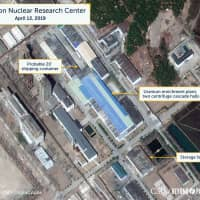 A view of what researchers of Beyond Parallel, a CSIS project, describe as a probably 20-foot shipping container near the uranium enrichment plant at the Yongbyon Nuclear Research Center in North Pyongan Province, North Korea, is seen in this commercial satellite image taken April 12 and released Tuesday. | CSIS / BEYOND PARALLEL / DIGITALGLOBE 2019 / VIA REUTERS