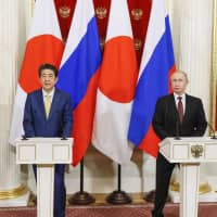 Prime Minister Shinzo Abe and Russian President Vladimir Putin hold a joint news conference at the Kremlin in Moscow on Jan. 22. | KYODO