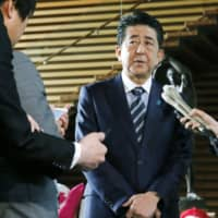 Abe likely to use upcoming big events to distract Japanese public from election routs, experts say