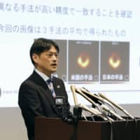 Mareki Homma from the National Astronomical Observatory of Japan speaks at a news conference in Tokyo's Chiyoda Ward on Thursday after the first-ever image of a black hole was unveiled by an international team of scientists. | KYODO