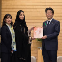Members of civil society organizations from Japan and the rest of the world present Civil 20's recommendations for Japan's leadership of the Group of 20 to Prime Minister Shinzo Abe last week in Tokyo. | COURTESY OF C-20 JAPAN 2019